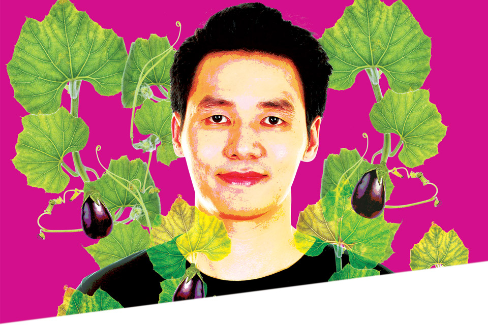 Posterized image of young man, head and shoulders, wearing black t-shirt, on fuscia background, encircled with green foliage and stylized eggplant graphics