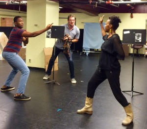 Michael Ooms with JuCoby Johnson and Sha' Cage in a rehearsal. (Photograph by Connie Shaver)