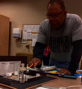 Director Warren C. Bowles with a model of Lance Brockman's set design for A Raisin in the Sun Photograph by Connie Shaver