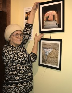 Jane Strauss with two of the photographs in her exhibit at Park Square Theatre (Photograph by Connie Shaver)