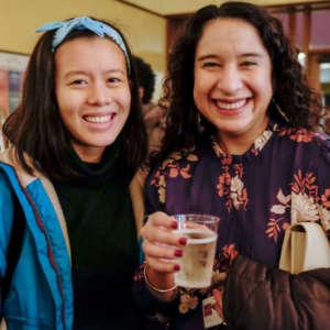 Two young women enjoying refreshments