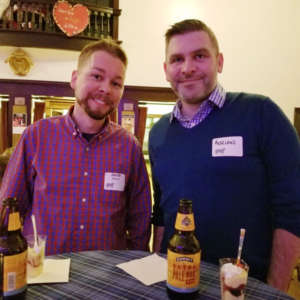 Two young men enjoying refreshements