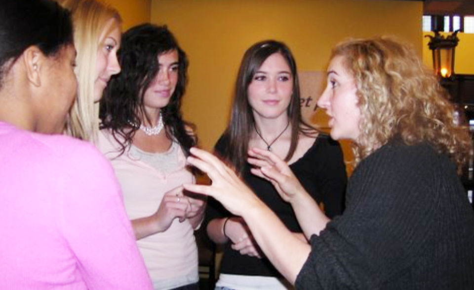 Four high-school age women having a discussion with a Park Square artistic staff member in the Theatre Ambassadors program