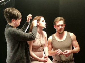 Sarah Bahr prepares Vanessa Wasche (Lady Macbeth) and Michael Ooms (Macbeth) for a photoshoot (Photo by Connie Shaver)