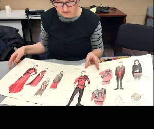 Sarah Bahr with some of her costume designs for Macbeth (Photo by Connie Shaver)